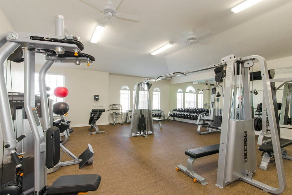 Well-equipped onsite fitness center at Olympus Woodbridge in Sachse, Texas