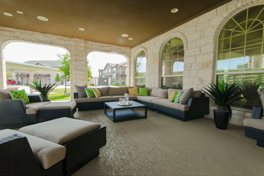 Expansive covered outdoor lounge at Olympus Woodbridge in Sachse, Texas