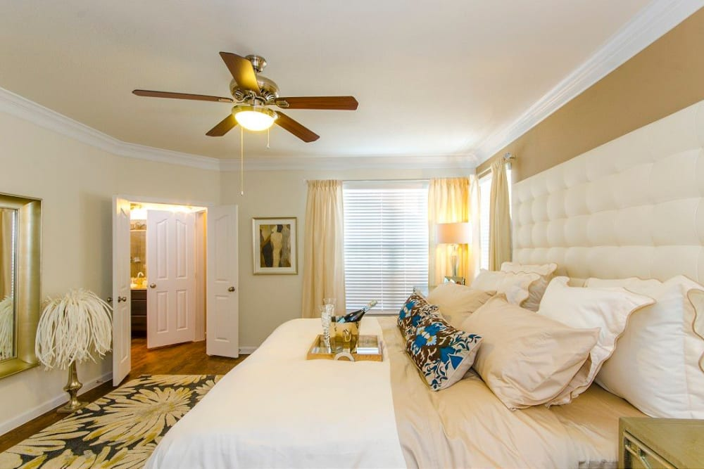 Beautifully furnished master bedroom in a model home at Olympus Woodbridge in Sachse, Texas