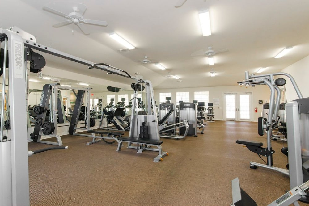 Very well-equipped onsite fitness center at Olympus Woodbridge in Sachse, Texas