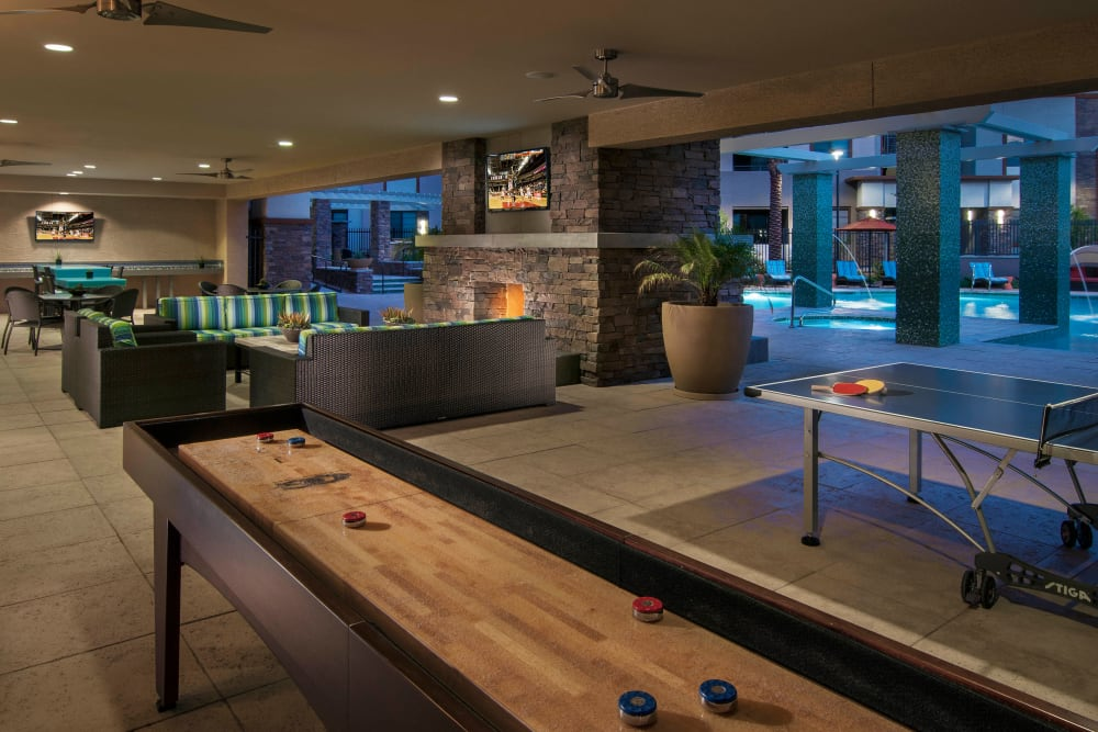Tabletop shuffleboard and more in the game room at Redstone at SanTan Village in Gilbert, Arizona