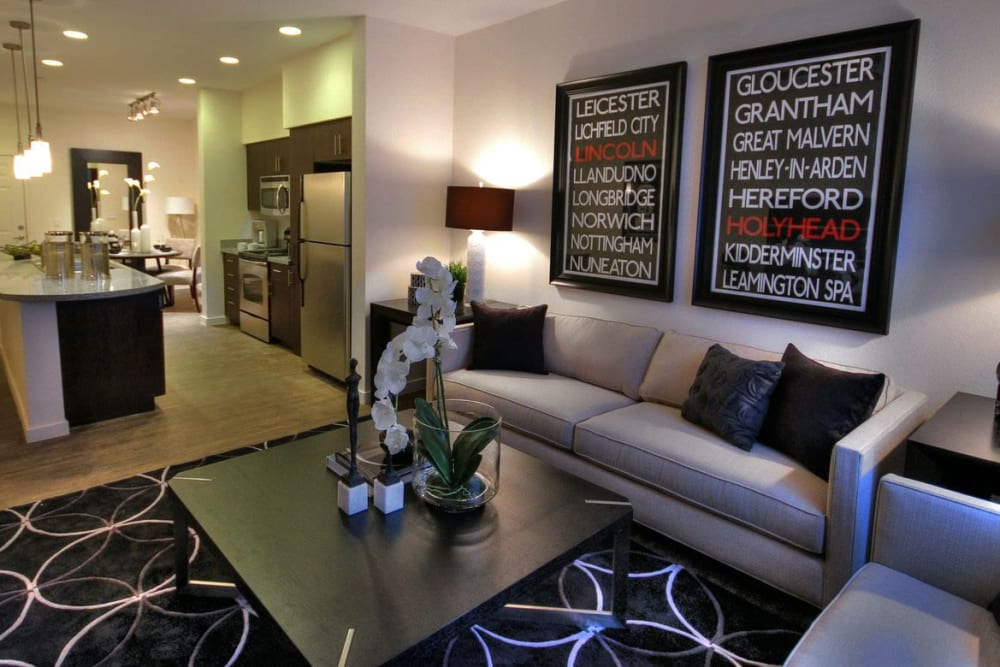 Well-furnished living area in a model home at Redstone at SanTan Village in Gilbert, Arizona