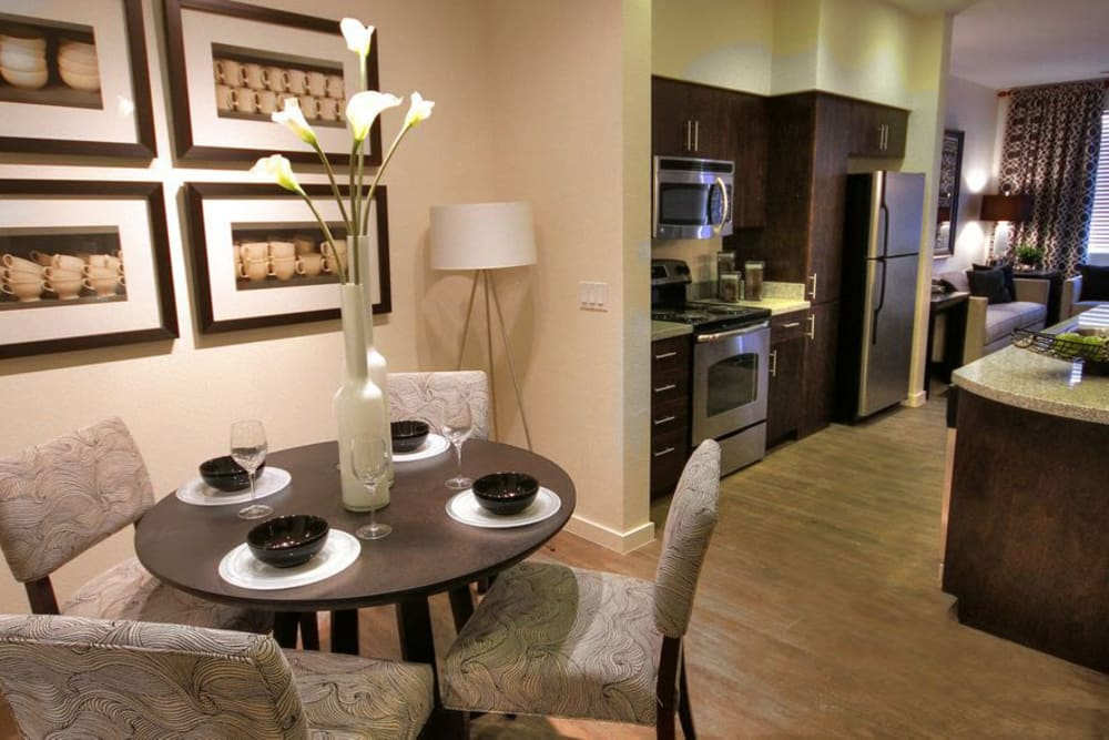 View of the gourmet kitchen from the dining area of a model apartment at Redstone at SanTan Village in Gilbert, Arizona