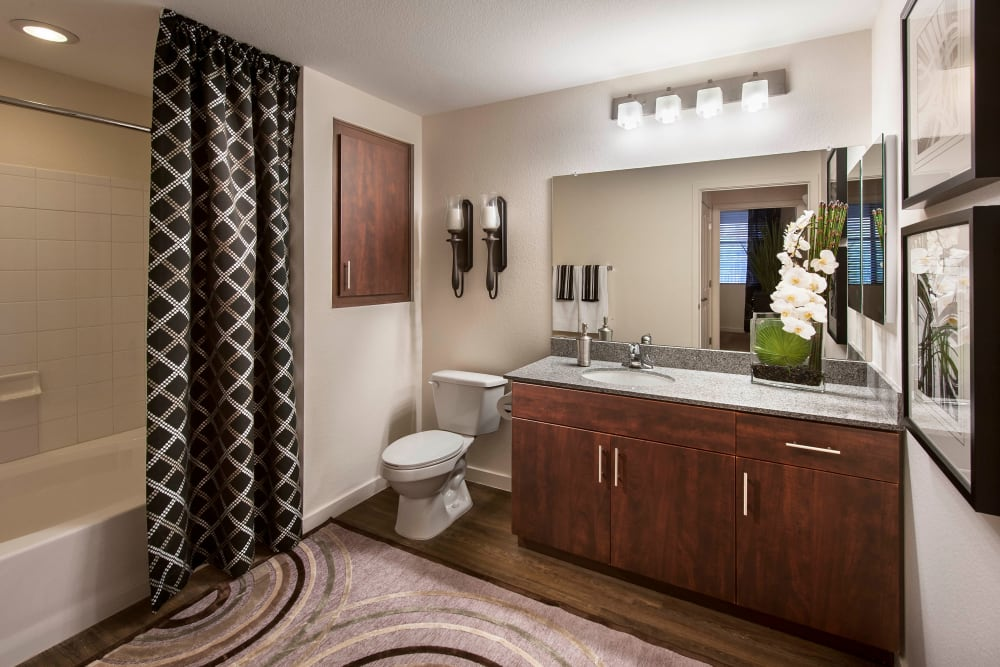 Spacious bathroom with a tiled shower in a model home at Redstone at SanTan Village in Gilbert, Arizona