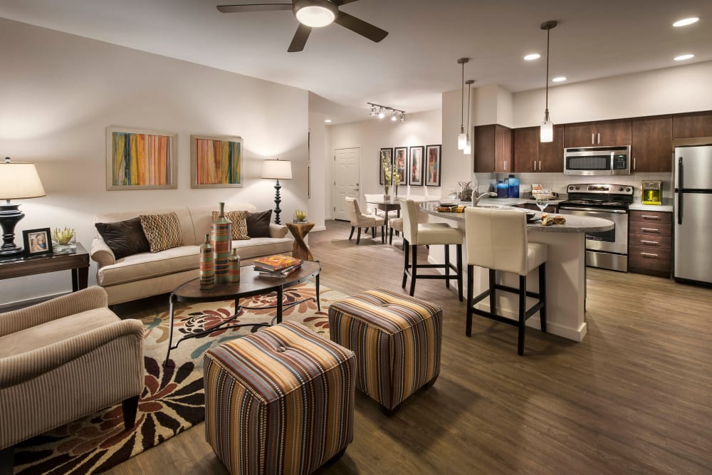Well-furnished pen-concept floor plan in a model home at Redstone at SanTan Village in Gilbert, Arizona