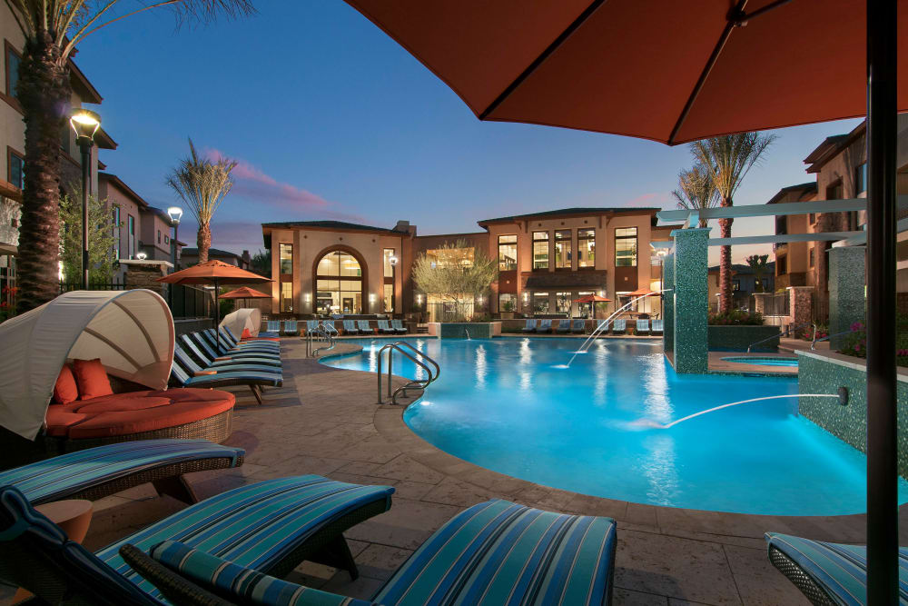 Swimming pool area at dusk at Redstone at SanTan Village in Gilbert, Arizona