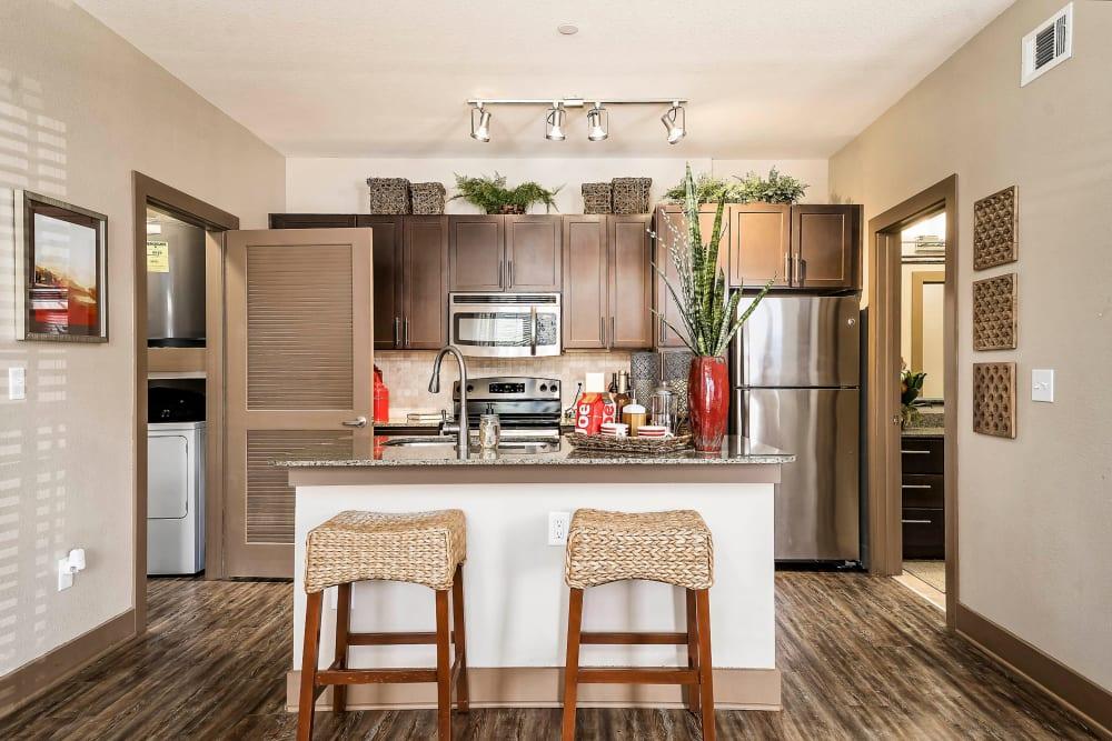 Gourmet kitchen with an island in a model home at Sedona Ranch in Odessa, Texas
