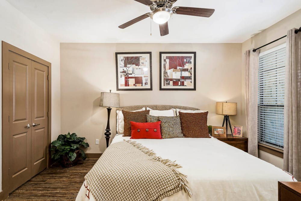 Ceiling fan in the well-furnished bedroom of a model apartment at Sedona Ranch in Odessa, Texas