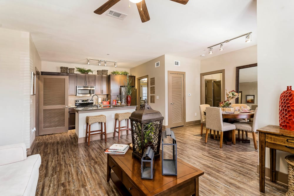 Ceiling fan and hardwood floors in the living areas of a model home at Sedona Ranch in Odessa, Texas