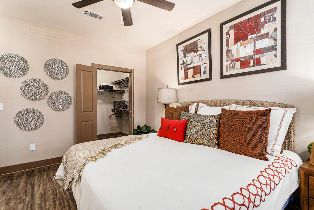 Well-furnished master bedroom with a ceiling fan in a model home at Sedona Ranch in Odessa, Texas