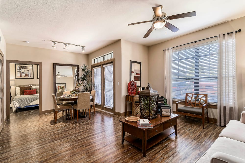 Ceiling fan and hardwood floors in the living area of a model apartment at Sedona Ranch in Odessa, Texas