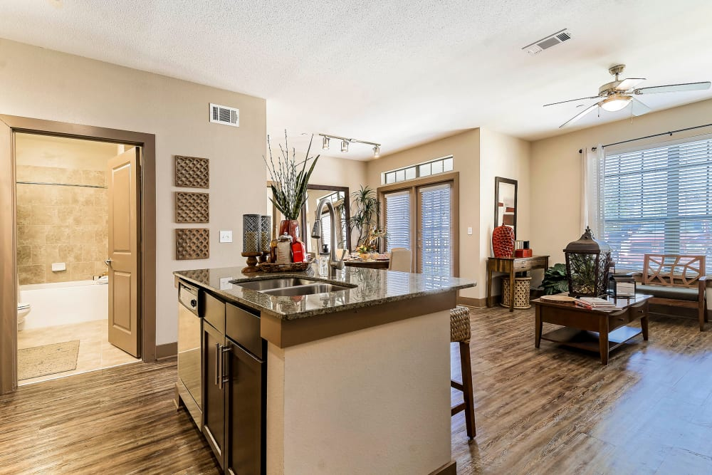 View of the living area from the open-concept kitchen of a model home at Sedona Ranch in Odessa, Texas