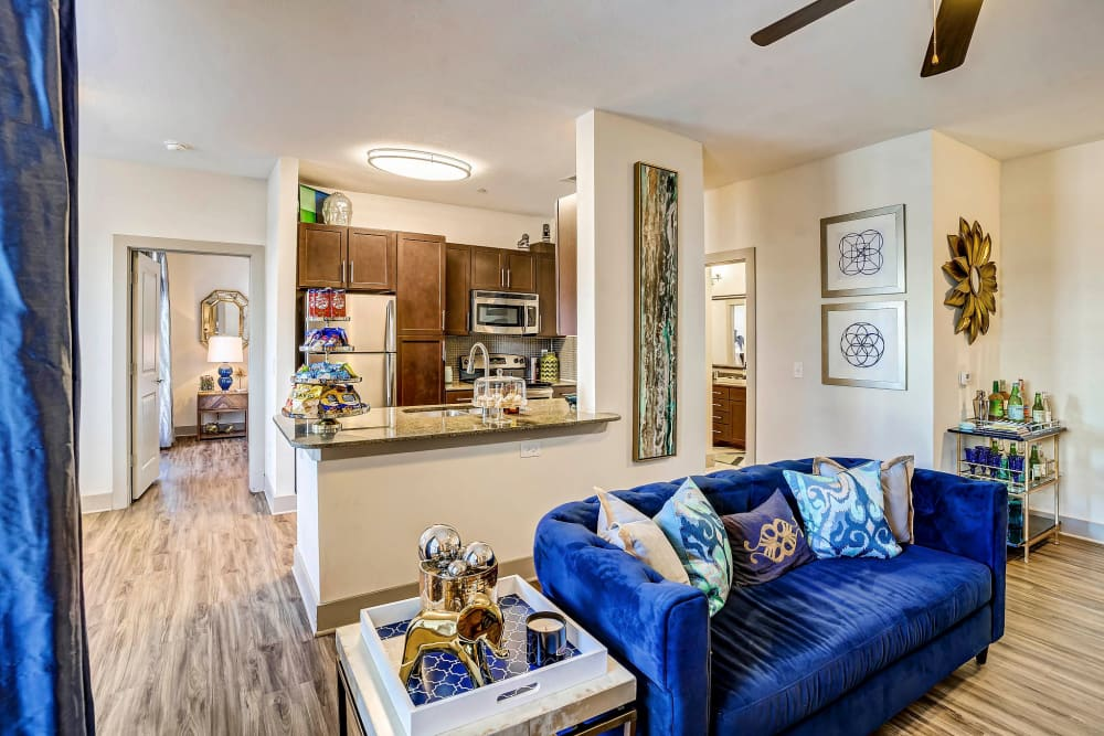 Well-furnished living area in a model home at Sundance Creek in Midland, Texas