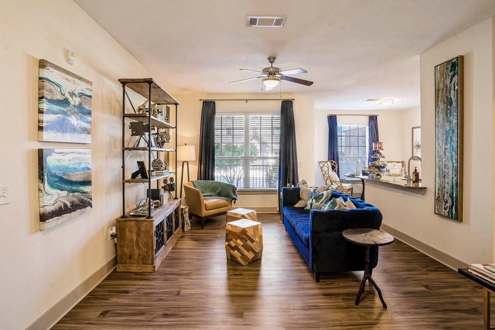 Hardwood floors and a ceiling fan in a model apartment at Sundance Creek in Midland, Texas