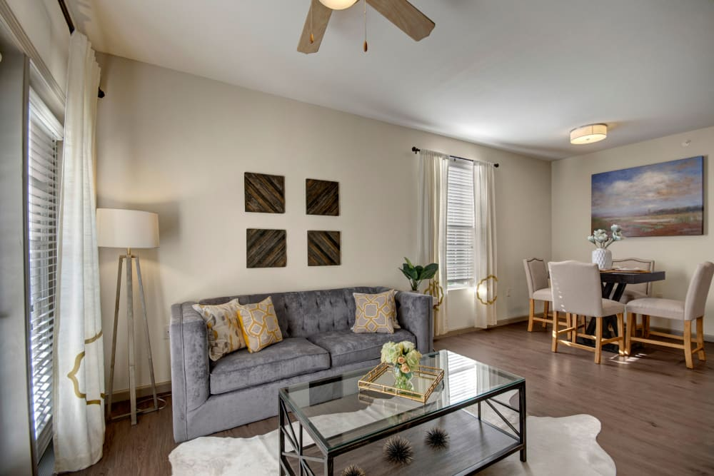 Well decorated living room with a ceiling fan at Creekside South in Wylie, Texas