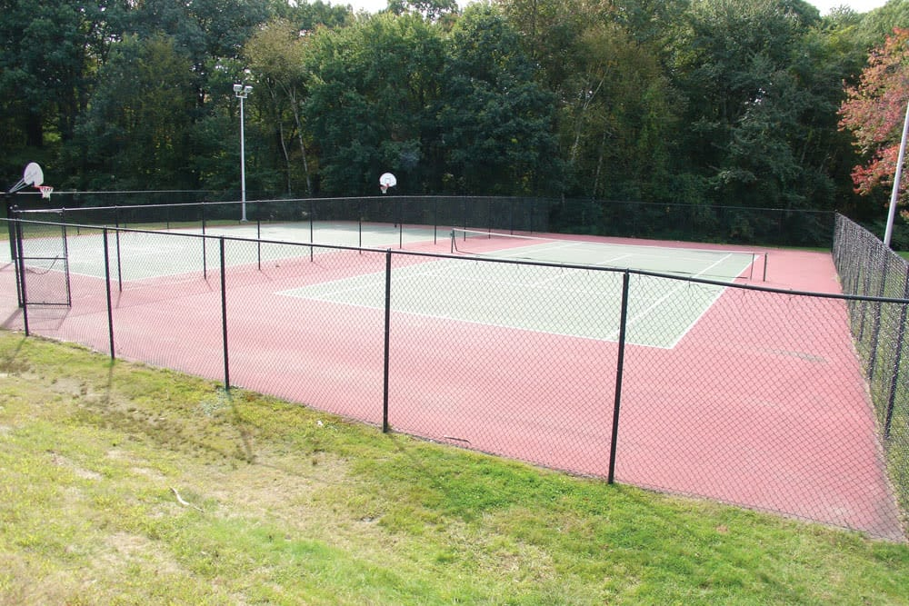 Tennis and basketball courts at Meadows at Marlborough in Marlborough, Massachusetts