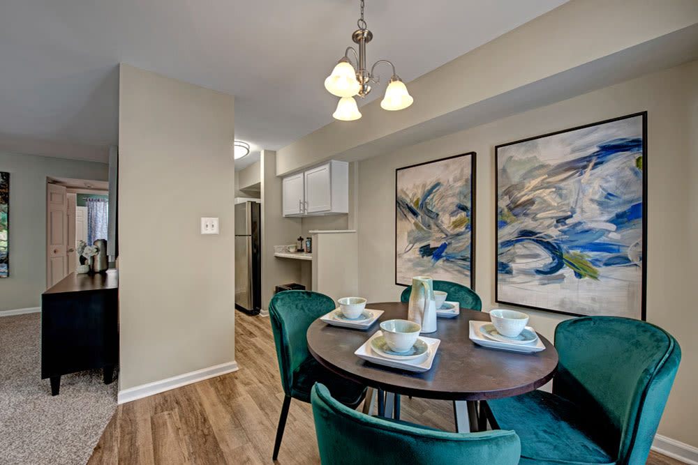 Dining table set for guests in an apartment at Howard Crossing in Ellicott City, Maryland