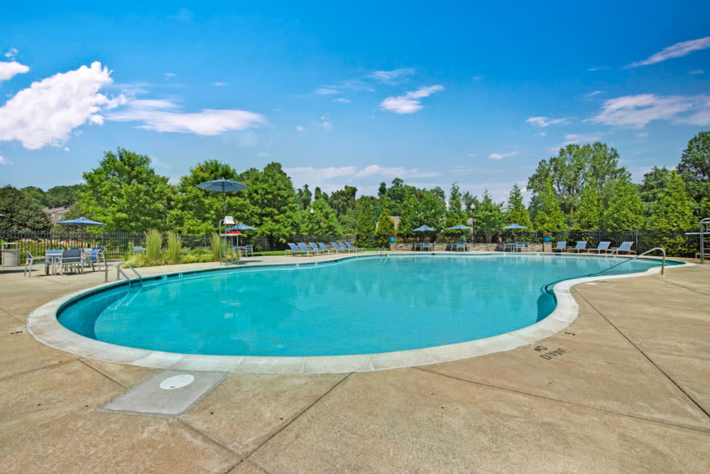 The outdoor community pool at Howard Crossing in Ellicott City, Maryland features abundant poolside lounge space