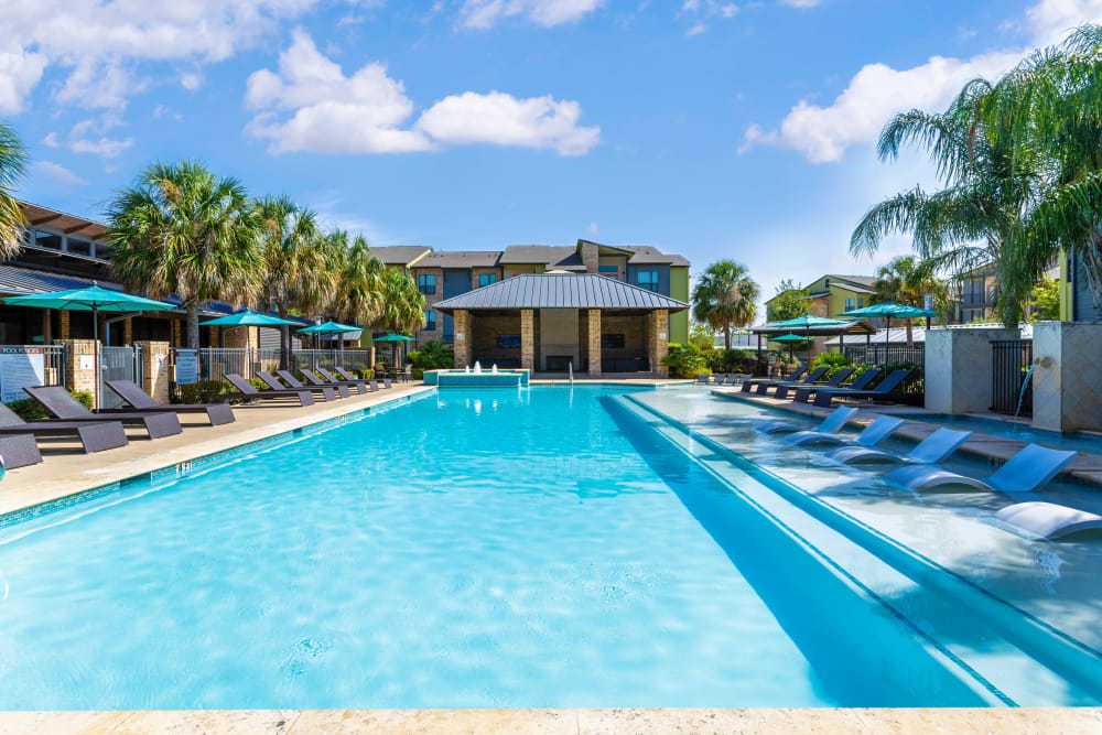 Resort-style swimming pool on a beautiful day at Tacara at Westover Hills in San Antonio, Texas