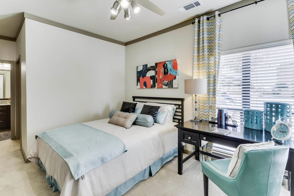 Ceiling fan and plush carpeting in a model home's master bedroom at Tacara at Westover Hills in San Antonio, Texas
