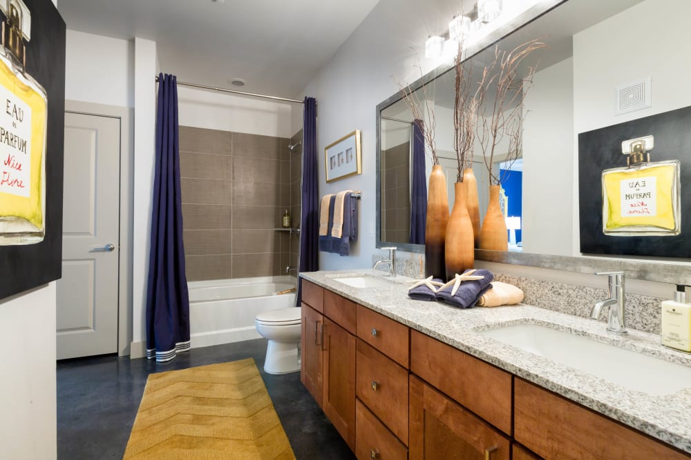 Spacious bathroom with granite countertops in a model home at The Davis in Fort Worth, Texas