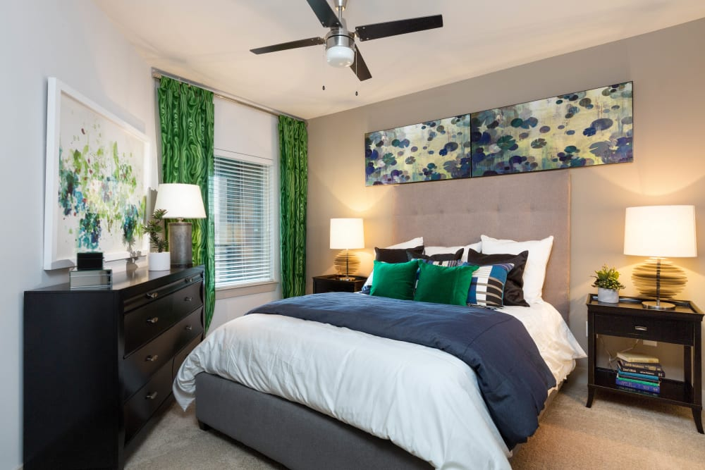 Ceiling fan and plush carpeting in a model apartment at The Davis in Fort Worth, Texas