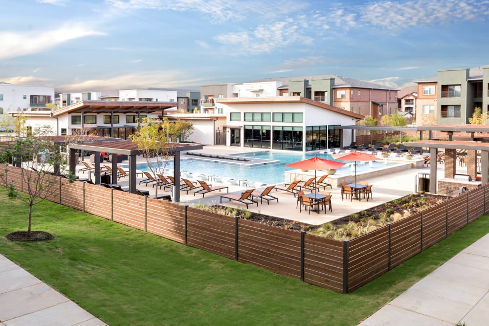 Resort-style swimming pool area at The Davis in Fort Worth, Texas