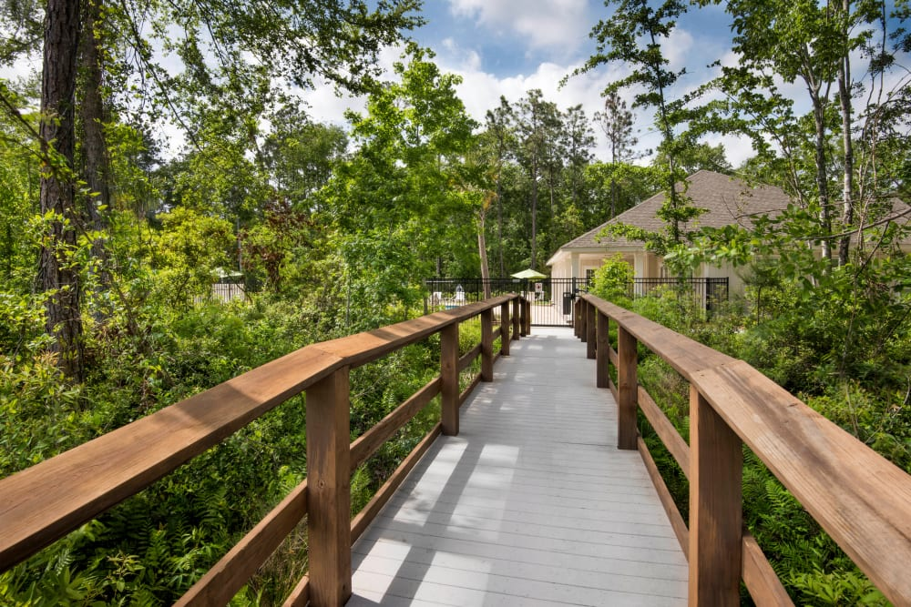 Wooden bridge over the creek and through mature trees at The Enclave in Brunswick, Georgia