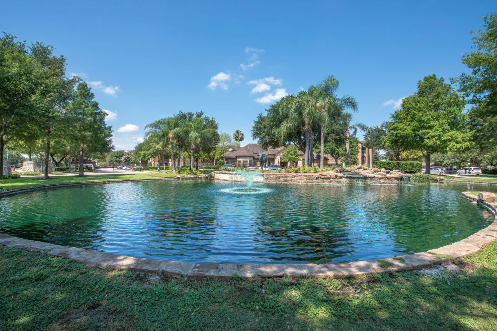 Beautiful pond surrounded by lush, mature trees at The Ranch at Shadow Lake in Houston, Texas