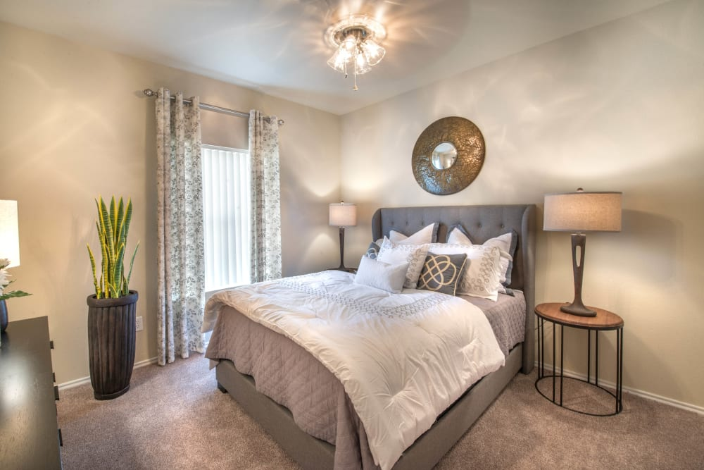 Ceiling fan and plush carpeting in a model home's bedroom at The Ranch at Shadow Lake in Houston, Texas
