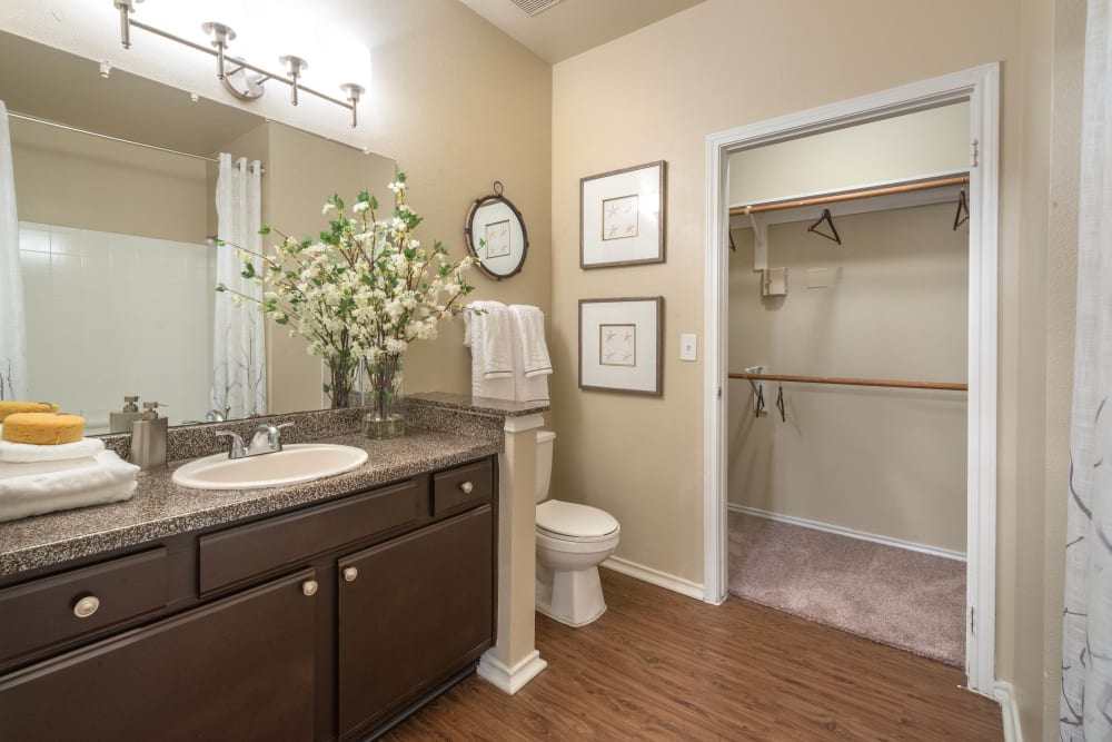 Granite countertop and plenty of storage space in a model home's bathroom at The Ranch at Shadow Lake in Houston, Texas