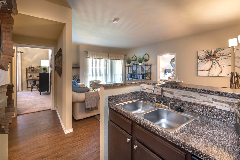 Beautiful granite countertops in the open-concept kitchen of a model home at The Ranch at Shadow Lake in Houston, Texas