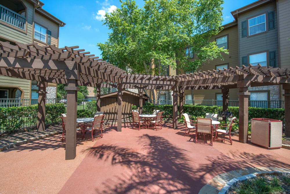 Expansive pergola providing some shade at one of the outdoor lounge areas at The Ranch at Shadow Lake in Houston, Texas