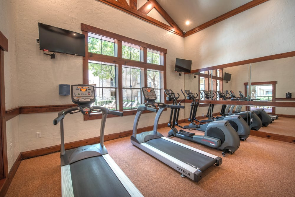 Ample cardio machines in the fitness center at The Ranch at Shadow Lake in Houston, Texas