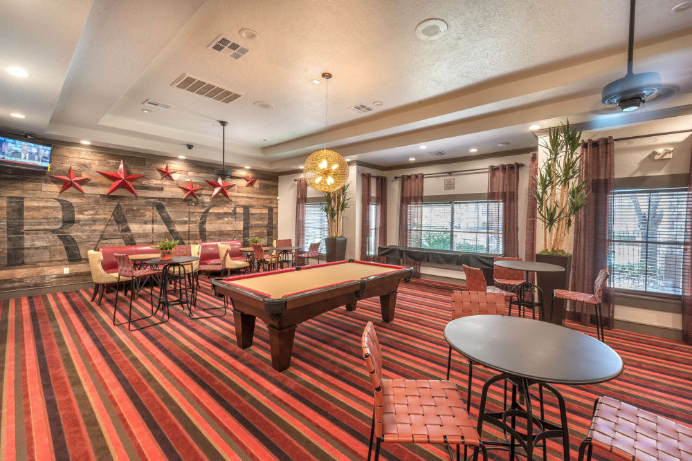 Game room with billiards in the clubhouse at The Ranch at Shadow Lake in Houston, Texas