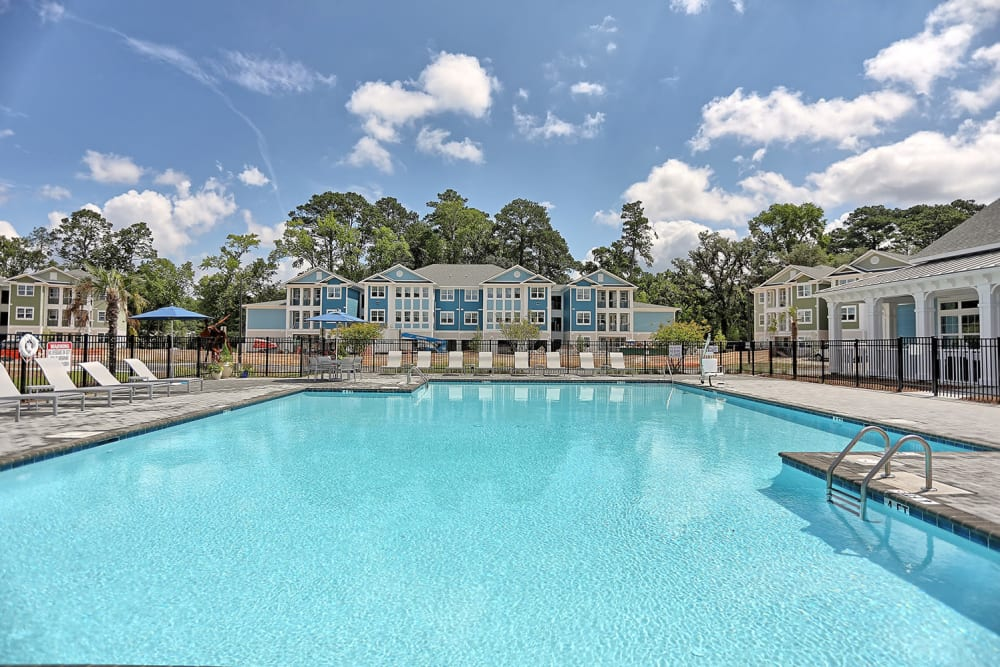 Resort-style swimming pool on a beautiful day at The Slate in Savannah, Georgia