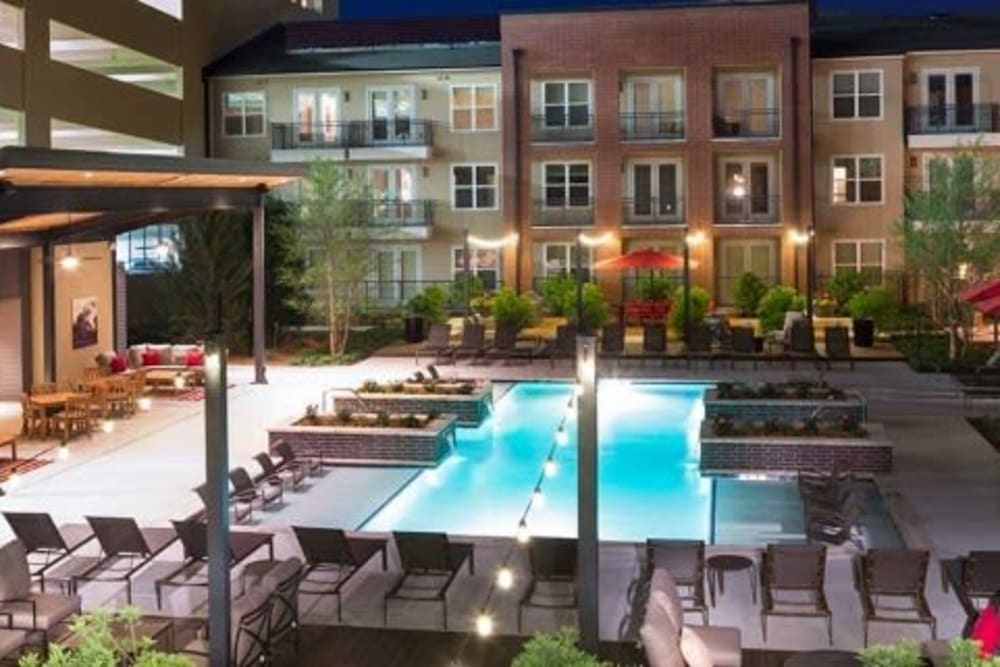 Early evening view of the swimming pool area at Union At Carrollton Square in Carrollton, Texas