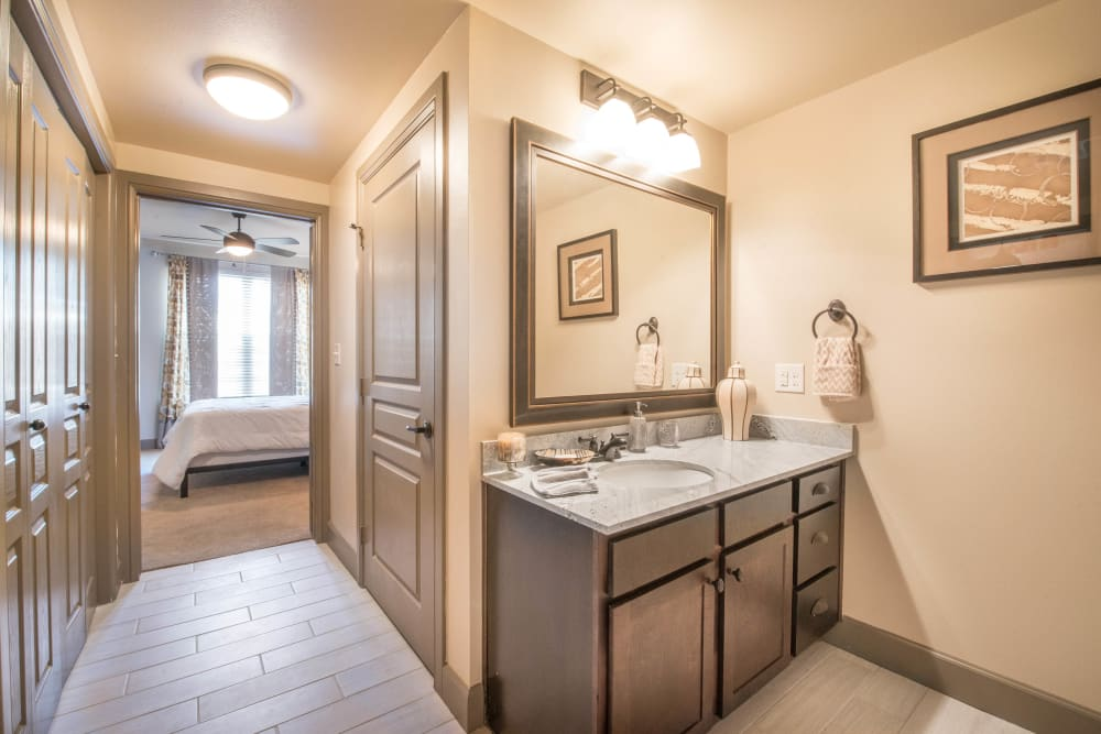 En suite master bathroom in a model home at Union At Carrollton Square in Carrollton, Texas