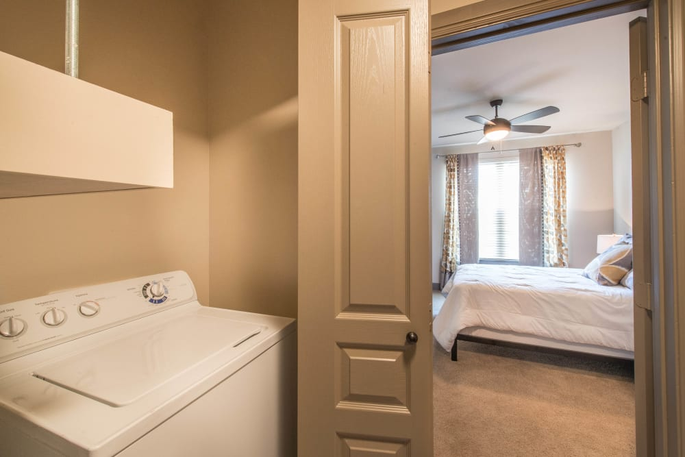 In-unit washer and dryer in a model apartment at Union At Carrollton Square in Carrollton, Texas