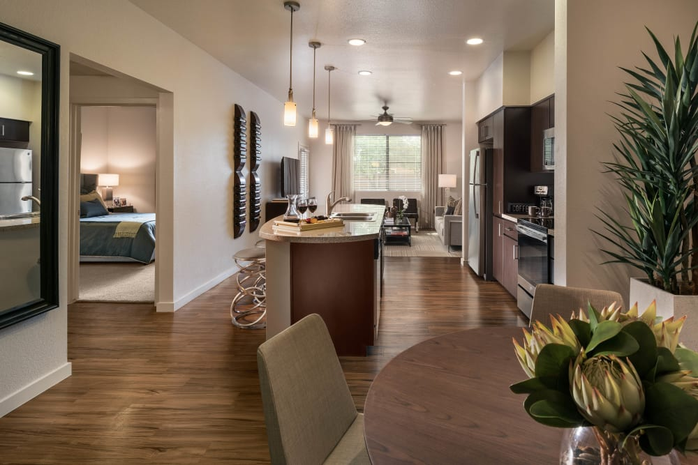 Spacious open-concept layout with beautiful hardwood flooring in a model home at Vistara at SanTan Village in Gilbert, Arizona