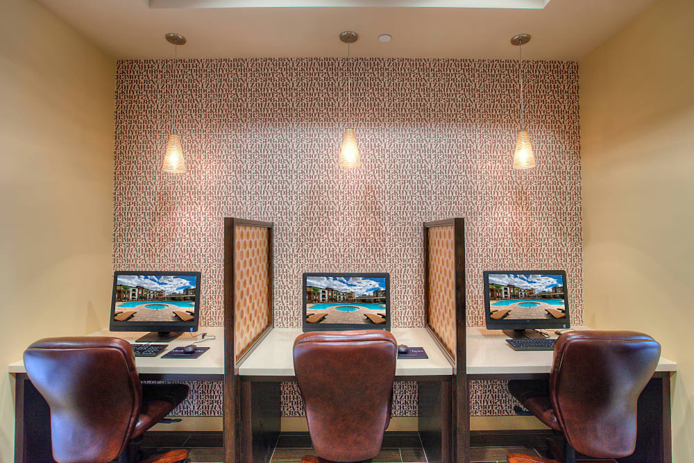 Business center with multiple workstations for resident use at Vistara at SanTan Village in Gilbert, Arizona