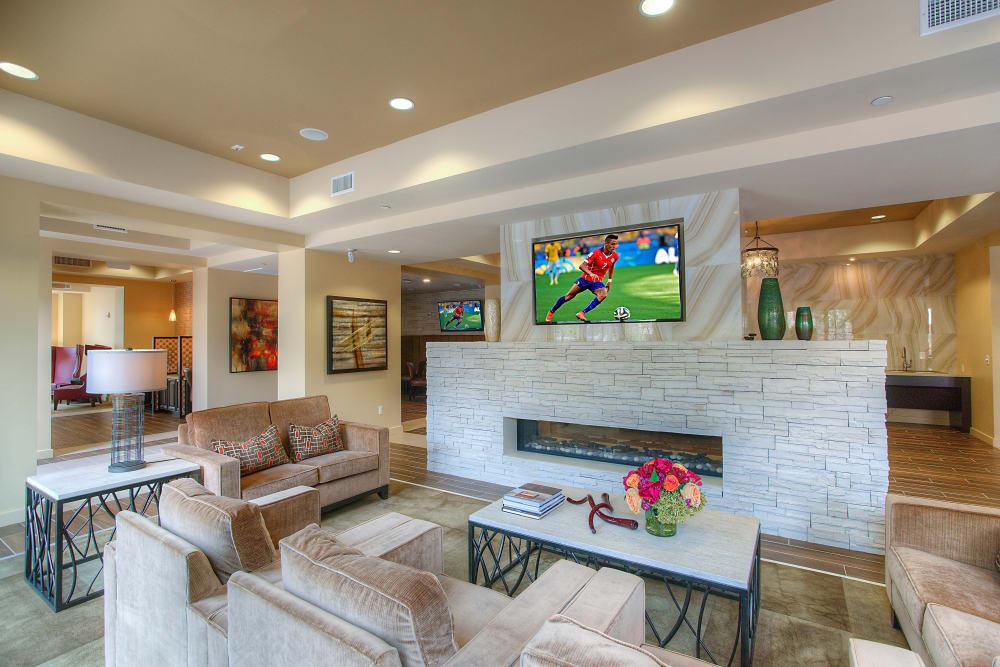 Flatscreen TVs and comfortable lounge areas in the clubhouse at Vistara at SanTan Village in Gilbert, Arizona