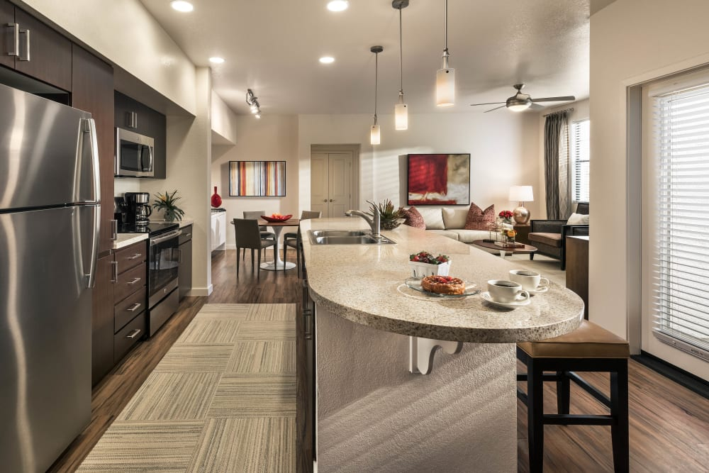 Beautiful gourmet kitchen with an island in a model home at Vistara at SanTan Village in Gilbert, Arizona