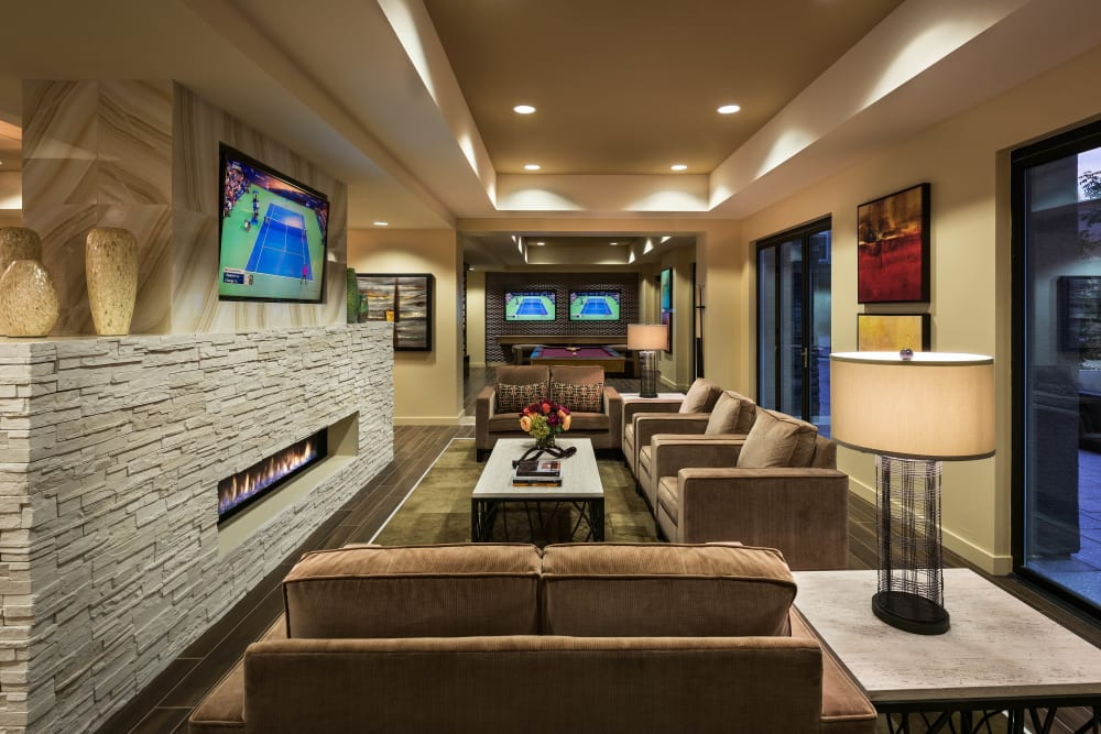 Fireplace and flatscreen TV in the clubhouse lounge at Vistara at SanTan Village in Gilbert, Arizona