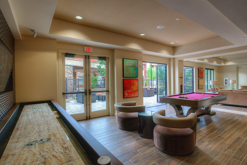 Billiards, tabletop shuffleboard, and more in the clubhouse game room at Vistara at SanTan Village in Gilbert, Arizona