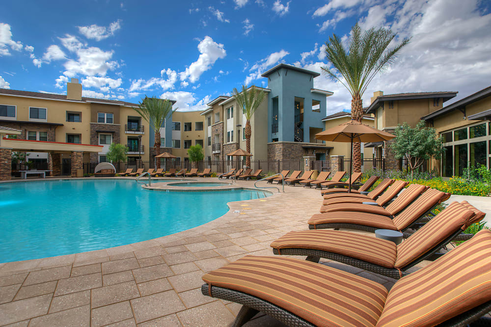 Lounge chairs flanking the pool at Vistara at SanTan Village in Gilbert, Arizona