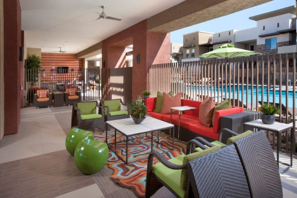 Covered outdoor lounge near the pool at Vive in Chandler, Arizona