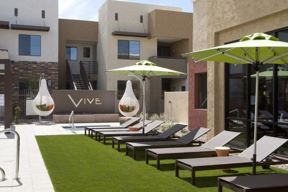Shaded lounge chairs at Vive in Chandler, Arizona
