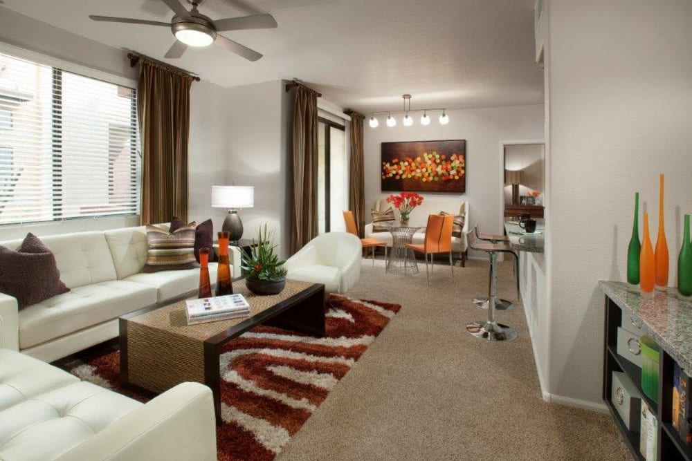Modern furnishings and a ceiling fan in a model home's living area at Vive in Chandler, Arizona