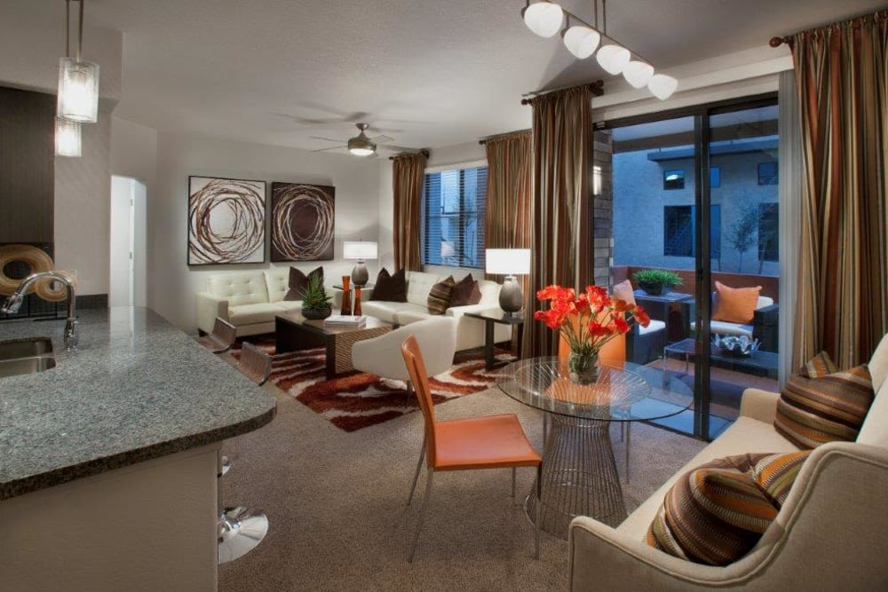 Plush carpeting throughout the living areas of a model apartment at Vive in Chandler, Arizona